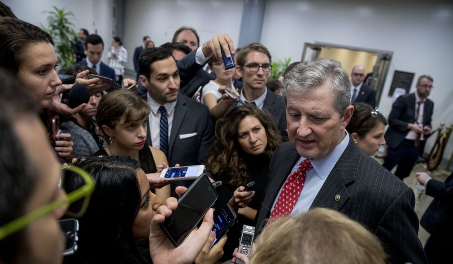 Sen. John Kennedy, R-La., speaks to reporters following a meeting with President Donald Trump on his tax reform agenda, Capitol Hill in Washington, Tuesday, Oct. 24, 2017. (Andrew Harnik/Associated Press) ** FILE **