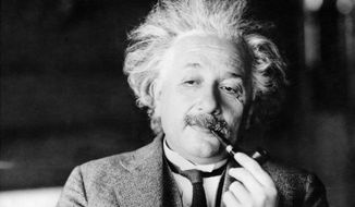 Legendary physicist Dr. Albert Einstein, author of the theory of Relativity, is lost in thought in an undated photo. (AP Photo) ** FILE **