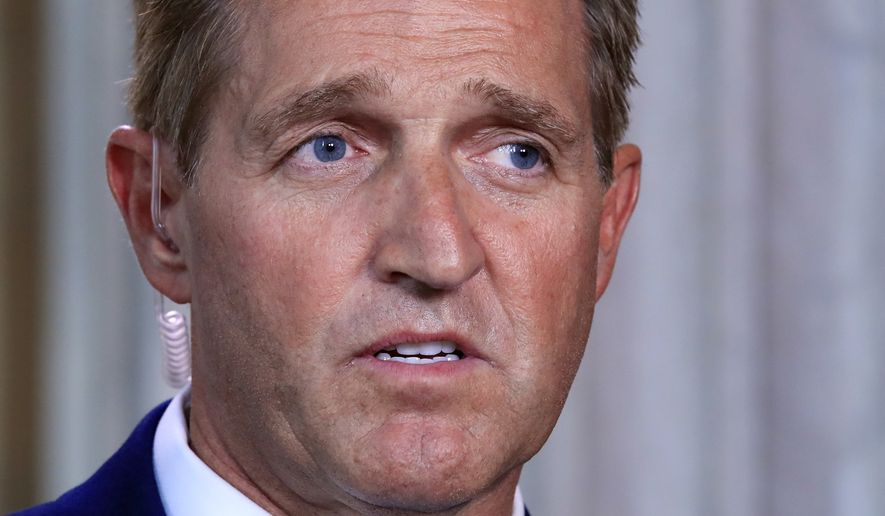 "Sen. Jeff Flake, Arizona Republican, announced he would not run for re-election next year, condemning in a speech aimed at President Trump the ""flagrant disregard of truth and decency"" that is undermining American democracy. (Associated Press)"
