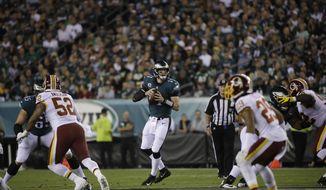 Philadelphia Eagles quarterback Carson Wentz (11) in action during an NFL football game against the Washington Redskins, Monday, Oct. 23, 2017, in Philadelphia. (AP Photo/Matt Rourke)