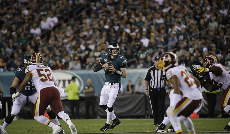 Philadelphia Eagles quarterback Carson Wentz (11) in action during an NFL football game against the Washington Redskins, Monday, Oct. 23, 2017, in Philadelphia. (AP Photo/Matt Rourke)
