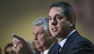 Rep. Devin Nunes (right), chairman of the House Permanent Select committee on intelligence, has widened the net in the panel's investigation into funding of a Russia dossier against Donald Trump. He now wants the names of journalists and law firms that Fusion GPS might have paid. (Associated Press/File)