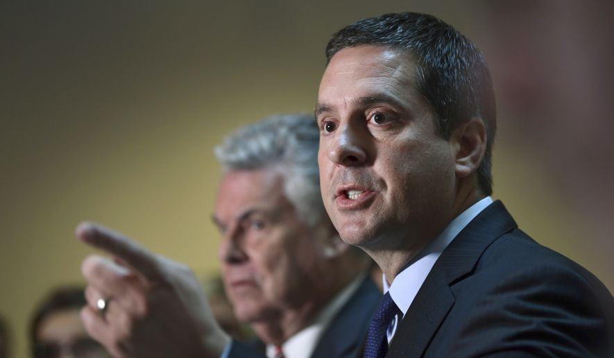 Rep. Devin Nunes (right), chairman of the House Permanent Select committee on intelligence, has widened the net in the panel's investigation into the use of the unconfirmed Russia dossier against Donald Trump. (Associated Press/File)