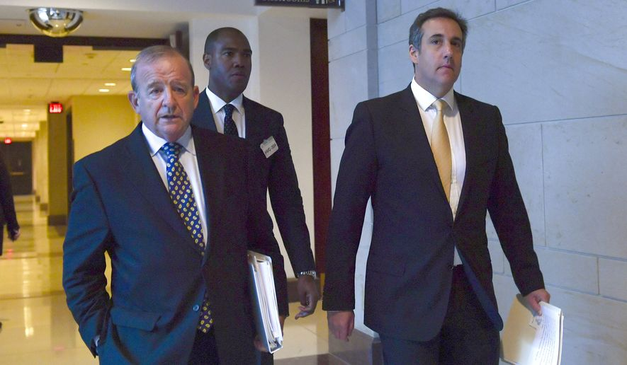 Michael Cohen, right, President Donald Trump's personal attorney, walks with his attorney Stephen M. Ryan, left, on Capitol Hill in Washington, Tuesday, Oct. 24, 2017, after an interview with the House Intelligence Committee. (AP Photo/Susan Walsh)