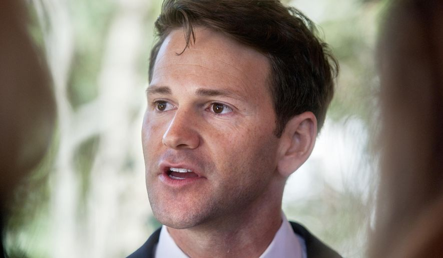FILE - In this Nov. 10, 2016 file photo, former Illinois U.S. Rep. Aaron Schock talks to reporters in Peoria Heights, Ill. A federal judge in Illinois has tossed two counts in a 24-count indictment of Schock, including a count alleging he pocketed thousands of dollars by arranging meet-and-greets for his constituents in Washington. Judge Colin Bruce ruled late Monday Oct. 14, 2017 that prosecutors would have to rely on legislative rules to prove the allegation about the annual events. (Matt Dayhoff/Journal Star via AP, File)