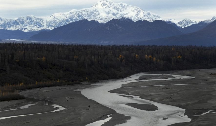 In this Sunday, Oct. 1, 2017 North America's tallest peak, Denali, is seen from a turnout in Denali State Park, Alaska. The peak was renamed from Mount McKinley to Denali under President Barack Obama. Alaska U.S. Sen. Dan Sullivan recently said he and Sen. Lisa Murkowski told President Donald Trump they support keeping the name Denali. (AP Photo/Becky Bohrer)