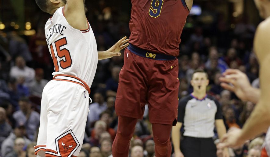 Cleveland Cavaliers' Dwyane Wade, right, shoots over Chicago Bulls' Denzel Valentine in the first half of an NBA basketball game, Tuesday, Oct. 24, 2017, in Cleveland. (AP Photo/Tony Dejak)