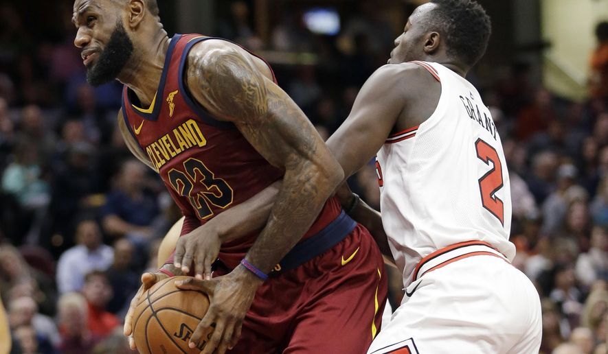 Cleveland Cavaliers' LeBron James, left, is fouled by Chicago Bulls' Jerian Grant in the first half of an NBA basketball game, Tuesday, Oct. 24, 2017, in Cleveland. (AP Photo/Tony Dejak)