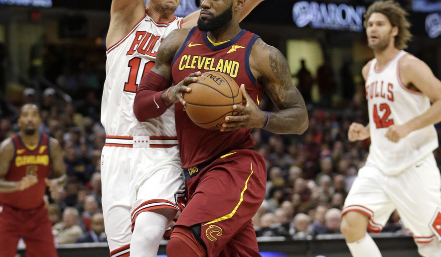 Cleveland Cavaliers' LeBron James, right, drives past Chicago Bulls' Paul Zipser, from Germany, in the first half of an NBA basketball game, Tuesday, Oct. 24, 2017, in Cleveland. (AP Photo/Tony Dejak)