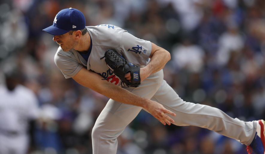 FILE - In this Oct. 1, 2017, file photo, Los Angeles Dodgers starting pitcher Brandon McCarthy (38) in the sixth inning of a baseball game Sunday,, in Denver. Shortstop Corey Seager and right-hander Brandon McCarthy were added to the active roster for the World Series by the Los Angeles Dodgers, who dropped outfielder Curtis Granderson and backup catcher Kyle Farmer. (AP Photo/David Zalubowski, File)