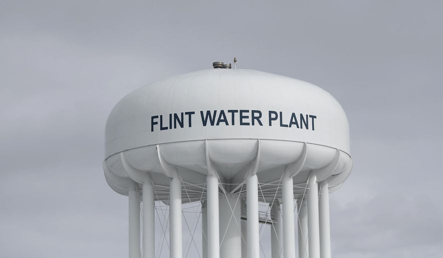 FILE - In this Feb. 26, 2016, file photo, the Flint Water Plant tower stands in Flint, Mich. The City Council voted Monday, Oct. 23, 2017, to extend a short-term contract for drinking water after requesting more time to comply with a federal judge's order to choose a long-term water source. (AP Photo/Paul Sancya, File)