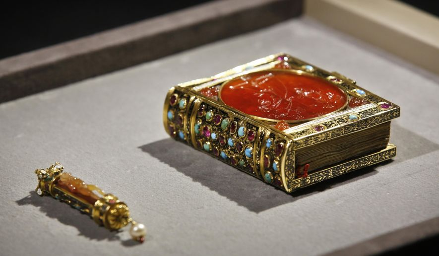 A prayer book (1532) that belongs to a private British collector, and which was once owned by the court of French King Francois I (1494-1547) is displayed during a crowdfunding campaign, at the Louvre museum, in Paris, Tuesday, Oct. 24, 2017. The Louvre museum hopes to bing back to France one of the French Renaissance's most prized decorative art pieces. (AP Photo/Thibault Camus)