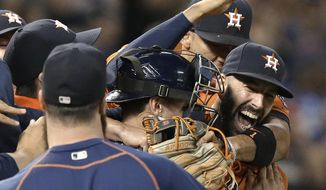 FILE - This Aug. 21, 2015, file photo shows Houston Astros starting pitcher Mike Fiers, right, being mobbed by teammates after his no-hitter against the Los Angeles Dodgers in a baseball game in Houston. The 2017 baseball season has in many ways been defined by the dominance of three teams. The dominance of the Astros, Dodgers and Cleveland Indians raised a fun question: What was the best team in the history of those franchises? The AP took a shot at answering this for every team in baseball, creating a timeline of greatness spanning over a century. (AP Photo/Pat Sullivan, File)