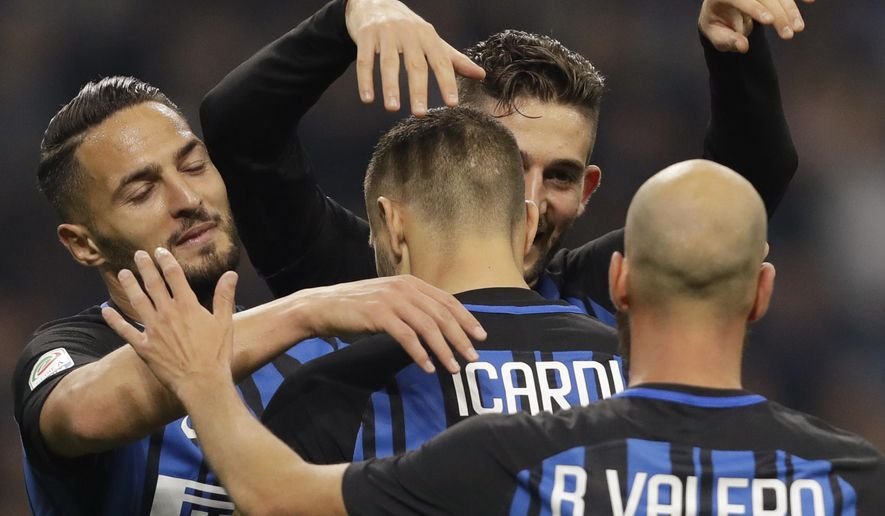 Inter's captain Mauro Icardi, center, back to camera, celebrates after scoring his side's third goal during an Italian Serie A soccer match between Inter Milan and Sampdoria, at the San Siro stadium in Milan, Italy, Tuesday, Oct. 24, 2017. (AP Photo/Luca Bruno)