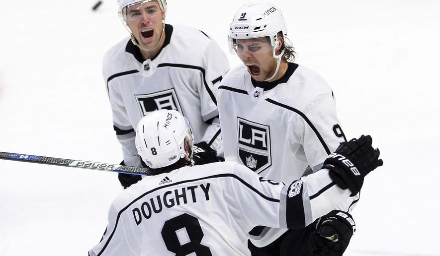 Los Angeles Kings left wing Adrian Kempe, right, celebrates his goal against the Ottawa Senators with teammates Tanner Pearson, back, and Drew Doughty during the third period of an NHL hockey game in Ottawa on Tuesday, Oct. 24, 2017. (Sean Kilpatrick/The Canadian Press via AP)