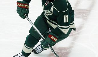 FILE - In this March 22, 2016, file photo, Minnesota Wild's Zach Parise skates against the Los Angeles Kings in the first period of an NHL hockey game in St. Paul, Minn.  Parise will miss at least two more months, after undergoing surgery on his lower back, the Wild announced Tuesday, Oct. 24, 2017.  (AP Photo/Jim Mone, File)