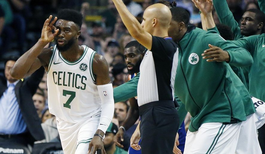 Boston Celtics' Jaylen Brown (7) celebrates his three-pointer during the first quarter of an NBA basketball game against the New York Knicks in Boston, Tuesday, Oct. 24, 2017. (AP Photo/Michael Dwyer)