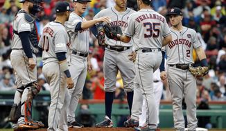FILE - In this Oct. 9, 2017, file photo, Houston Astros manager A.J. Hinch, third from left, gives the ball to pitcher Justin Verlander (35) for his very first Major League relief appearance during the fifth inning in Game 4 of baseball's American League Division Series against the Boston Red Sox,  in Boston. No need for catchers to worry about getting they're running in, especially during the postseason. They are taking so many trips to the mound for discussions, the average time of a nine-inning game is 3 hours, 32 minutes during the postseason, up 18 minutes since 2015. (AP Photo/Michael Dwyer, File)
