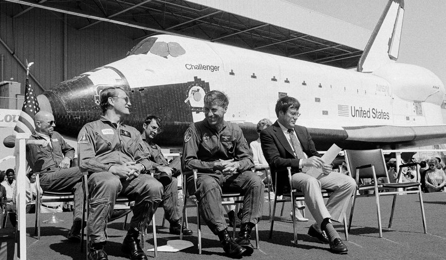 FILE - In this June 30, 1982, file photo, the new space shuttle Challenger sits behind the four astronauts that will fly it during turnover ceremonies at Rockwell International's final assembly site in Palmdale, Calif. From left: Dr. Story Musgrave, pilot Karol J. Bobko, mission specialist Donald H. Peterson and commander Paul J. Weitz. Weitz, a retired NASA astronaut who commanded the first flight of the space shuttle Challenger and flew on Skylab in the early 1970s, has died at 85. Weitz died at his retirement home in Flagstaff, Ariz., on Monday, Oct. 23, 2017, said Laura Cutchens of the Astronaut Scholarship Foundation. (AP Photo/Doug Pizac, File)