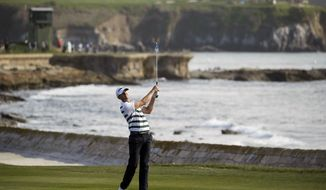 FILE - In this Feb. 14, 2016, file photo, Vaughn Taylor chips the ball up to the 18th green of the Pebble Beach Golf Links during the final round of the AT&T Pebble Beach National Pro-Am golf tournament in Pebble Beach, Calif. Prestigious Pebble Beach will host its first U.S. Women's Open in 2023 and the U.S. Open in 2027. The USGA announced the two tournaments slated for Pebble Beach on Tuesday, Oct. 24, 2017. (AP Photo/Eric Risberg, File)