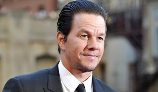 """FILE - In this Tuesday, June 20, 2017, file photo, Mark Wahlberg attends the U.S. premiere of """"Transformers: The Last Knight"""" at the Civic Opera House on in Chicago. Wahlberg told the Chicago Tribune on Oct. 20, 2017, that he hopes God will forgive him for his turn as a porn star in the 1997 film """"Boogie Nights."""" (Photo by Rob Grabowski/Invision/AP, File)"""