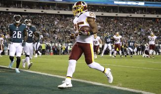Washington Redskins running back Chris Thompson (25) scores a touchdown uncontested against the Philadelphia Eagles during the first half of an NFL football game, Monday, Oct. 23, 2017, in Philadelphia. (AP Photo/Matt Rourke)