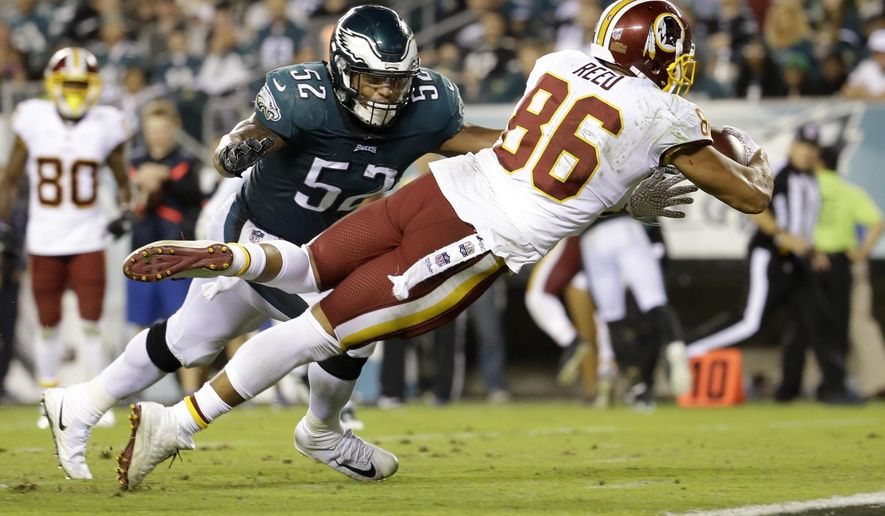 Washington Redskins tight end Jordan Reed (86) dives in for a touchdown on a pass from quarterback Kirk Cousins, not pictured, as Philadelphia Eagles linebacker Najee Goode (52) tries to stop him during the second half of an NFL football game, Monday, Oct. 23, 2017, in Philadelphia. (AP Photo/Michael Perez)