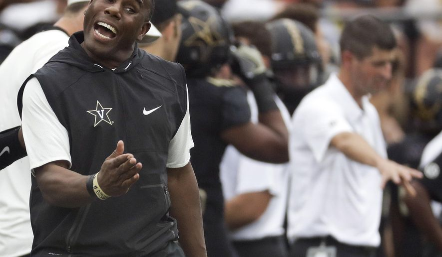 FILE - In this Oct. 7, 2017, file photo, Vanderbilt head coach Derek Mason yells to his players during the first half of an NCAA college football game against Georgia in Nashville, Tenn. The Commodores finally had a week off to rest up and catch their breath after a grueling month of ranked opponents. Now the big question is whether or not they can get back to how well they played when the season started as they prepare to visit South Carolina. (AP Photo/Mark Humphrey, File)