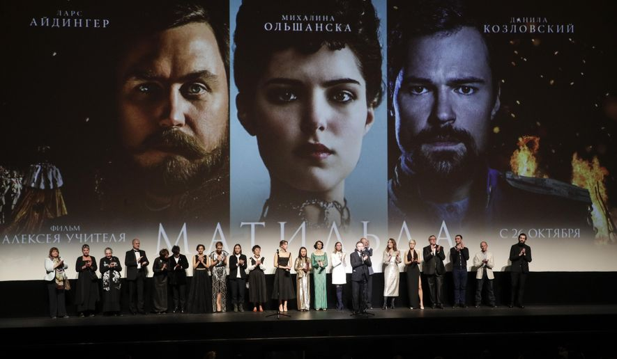 "Alexei Uchitel, Russian film director of ""Matilda,"" a movie about the last Russian czar's affair with a ballerina and his movie crew applaud at the stage at the Mariinsky Theatre in Moscow, Russia, Monday, Oct. 23, 2017. ""Matilda"" loosely tells the story of Nicholas II's infatuation with prima ballerina Matilda Kshesinskaya angered hard-line nationalists and some Orthodox believers in Russia, who see it as blasphemy against the emperor, glorified as a saint by the Russian Orthodox Church. (AP Photo/Dmitri Lovetsky)"