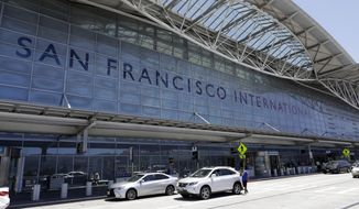 FILE - In this Tuesday, July 11, 2017, file photo, vehicles wait outside the international terminal at San Francisco International Airport in San Francisco. The Federal Aviation Authority is investigating why an Air Canada plane ignored repeated orders by an air traffic controller at San Francisco International Airport to abort a landing on Sunday, Oct. 22. The incident comes three months after another Air Canada plane nearly landed on a crowded taxiway at the airport. (AP Photo/Marcio Jose Sanchez, File)