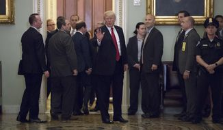 President Donald Trump leaves the Capitol after lunch with Senate Majority Leader Mitch McConnell, R-Ky., and Senate Republicans to talk about his tax reform agenda, in Washington, Tuesday, Oct. 24, 2017. (AP Photo/J. Scott Applewhite)