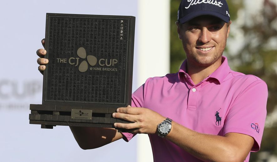 Winner Justin Thomas of the United States poses with his trophy after winning the CJ Cup golf tournament at Nine Bridges on Jeju Island, South Korea, Sunday, Oct. 22, 2017. (Park Ji-ho/Yonhap via AP)