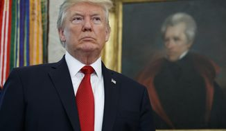 President Donald Trump listens as he is introduced to speak with winners from the National Minority Enterprise Development Week Awards Program, in the Oval Office of the White House, Tuesday, Oct. 24, 2017, in Washington. (AP Photo/Evan Vucci)