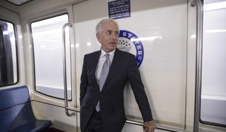 """Senate Foreign Relations Committee Chairman Bob Corker, R-Tenn., pauses while riding the Senate subway to the Capitol during a day of jabs on social media with President Donald Trump, on Capitol Hill in Washington, Tuesday, Oct. 24, 2017. In a remarkable Republican war of words, Corker says Trump is """"utterly untruthful"""" and debases the nation. Then the president fires back that the two-term lawmaker """"couldn't get elected dog catcher."""" (AP Photo/J. Scott Applewhite)"""