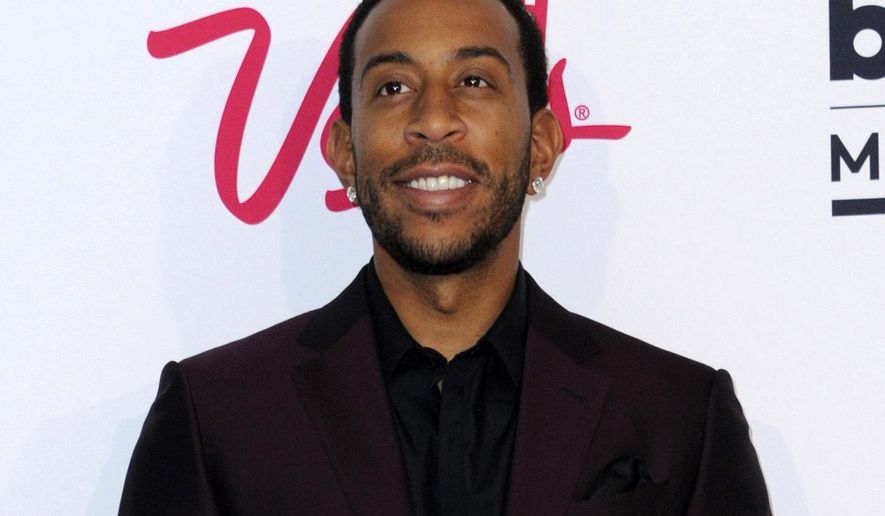 """FILE - In this May 22, 2016 file photo, Ludacris poses in the press room at the Billboard Music Awards in Las Vegas. Ludacris will host a YouTube series. """"Best.Cover.Ever,"""" which pairs budding musicians with established stars for a shot at performing a duet on the online giant. The 10-episode series debuts Nov. 20. (Photo by Richard Shotwell/Invision/AP, File)"""