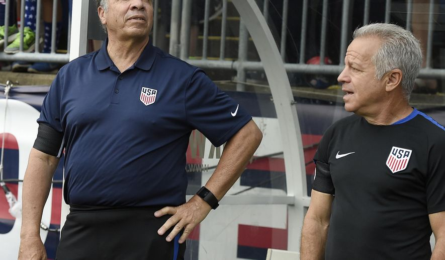 FILE - In this July 1, 2017, file photo, U.S. coach Bruce Arena, left, and assistant coach Dave Sarachan watch team introductions for an international friendly soccer match against Ghana in East Hartford, Conn. Sarachan, the top assistant to Arena, will be the interim coach for the United States when the Americans play an exhibition at European champion Portugal on Nov. 14. Arena quit Oct. 13, three days after the Americans lost 2-1 at 99th-ranked Trinidad and Tobago and failed to qualify for next year's World Cup. (AP Photo/Jessica Hill, File)