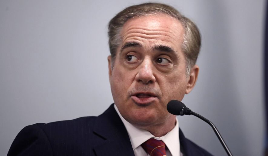 FILE - In this Aug. 4, 2017, file photo, Secretary of Veterans Affairs David Shulkin speaks during a visit to the Veterans Administration Medical Center in, Manchester, N.H. Shulkin is touting an overhaul plan to give veterans even wider access to outside doctors than under its troubled Veterans Choice health care program. He is stressing stronger ties with the private sector, even while acknowledging key questions of cost and sharing of medical records were still unresolved. Shulkin on Oct. 24, acknowledged the program would run out of money sooner than expected and urged Congress to provide new stopgap funding by year's end. (AP Photo/Charles Krupa, File)