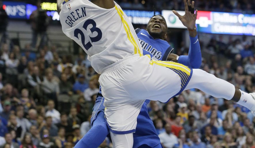 Golden State Warriors forward Draymond Green (23) stops Dallas Mavericks forward Nerlens Noel (3) from scoring during the second half of an NBA basketball game in Dallas, Monday, Oct. 23, 2017. The Warriors won 133-103. (AP Photo/LM Otero)