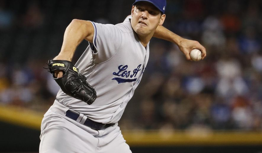 FILE - In this Tuesday, Aug. 29, 2017 file photo, Los Angeles Dodgers starting pitcher Rich Hill (44) throws against the Arizona Diamondbacks during the first inning of a baseball game in Phoenix. Rich Hill and Hollywood seem to go together. Twenty-six months ago, he was pitching for the Long Island Ducks in the independent Atlantic League. And on Wednesday night, Oct. 25, 2017, the 37-year-old left-hander will be on the mound for the Los Angeles Dodgers starting Game 2 of the World Series. (AP Photo/Matt York, File)