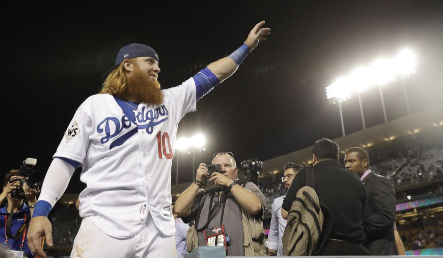 Los Angeles Dodgers third baseman Justin Turner waves has he leaves the field after Game 1 of baseball's World Series against the Houston Astros Tuesday, Oct. 24, 2017, in Los Angeles. The Dodgers won 3-1 to take a 1-0 lead in the series. (AP Photo/Matt Slocum)
