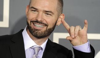 FILE - In this Sunday, Feb. 13, 2011, file photo, Paul Wall arrives at the 53rd annual Grammy Awards in Los Angeles. The Grammy-nominated rapper plans to make free grillz for the Houston Astros to celebrate their trip to the World Series as they take on the Los Angeles Dodgers (AP Photo/Chris Pizzello, File)