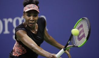 FILE - In this Sept. 7, 2017, file photo, Venus Williams, of the United States, returns a shot from Sloane Stephens, of the United States, during the semifinals of the U.S. Open tennis tournament in New York. Williams needed three match points and more than three hours to defeat Jelena Ostapenko 7-5, 6-7 (3), 7-5 at the WTA Finals in Singapore on Tuesday, Ot. 24, 2017.  (AP Photo/Julio Cortez, File)