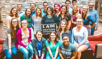 """Pro-life advocate Kristan Hawkins - shown with the sign in the center of the group - is president of Students for Life, and will tour college campuses to speak out against views of """"aging feminists."""" (Students for Life)"""