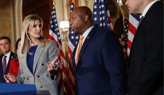 "Sen. Tim Scott (center), South Carolina Republican, said the top end of ""middle-income"" earners top out at $250,000, and decried Democrats who claim ""millionaires and billionaires start at $250,000, so I'm not going to put  weight on what they think unless they're willing to actually negotiate."" (Associated Press)"