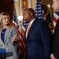 """Sen. Tim Scott (center), South Carolina Republican, said the top end of """"middle-income"""" earners top out at $250,000, and decried Democrats who claim """"millionaires and billionaires start at $250,000, so I'm not going to put  weight on what they think unless they're willing to actually negotiate."""" (Associated Press)"""