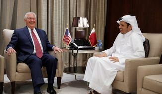 Secretary of State Rex W. Tillerson and Qatar's Foreign Minister Sheikh Mohammed bin Abdulrahman Al Thani smile before a meeting, Sunday, Oct. 22, 2017, in Doha, Qatar. (AP Photo/Alex Brandon, Pool) (Associated Pres)