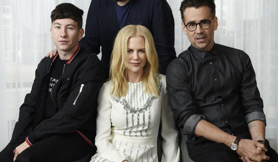 "In this Sept. 9, 2017 photo, writer-director Yorgos Lanthimos, background center, and cast members of ""The Killing of a Sacred Deer,"" from left, Barry Keoghan, Nicole Kidman and Colin Farrell pose for a portrait during the Toronto International Film Festival in Toronto. (Photo by Chris Pizzello/Invision/AP)"