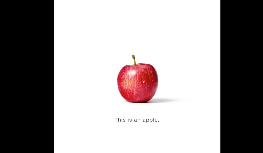 "Screen capture from CNN's ""This is an apple"" promo, which has been roundly mocked by conservatives and apolitical folks alike on social media. (YouTube)"