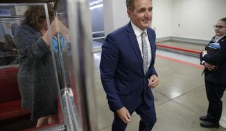 Sen. Jeff Flake, R-Ariz., a member of the Foreign Relations Committee, returns to his office after a closed-door security briefing at the Capitol in Washington, Wednesday, Oct. 25, 2017. (AP Photo/J. Scott Applewhite)