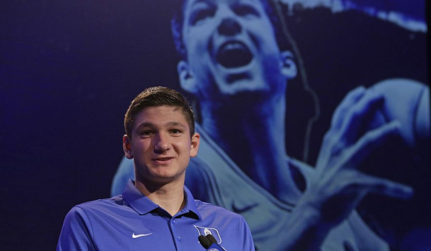 Duke's Grayson Allen answers a question during the Atlantic Coast Conference men's NCAA college basketball media day in Charlotte, N.C., Wednesday, Oct. 25, 2017. (AP Photo/Chuck Burton)